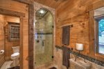 2nd Story Master Bathroom shower with a waterfall shower head